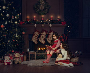 Lilia Alvarado TWO LITTLE GIRLS BY FIREPLACE WITH CHRISTMAS DECORATIONS Women