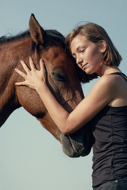 Magdalena Russocka close up of young girl hugging horse Women