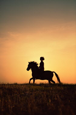 Magdalena Russocka young girl riding horse at sunset Women