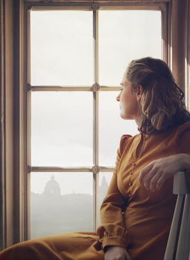 Mark Owen BLONDE WOMAN SITTING INDOORS BY WINDOW DAYDREAMING Women