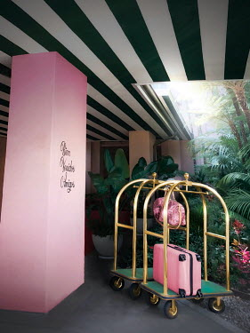 ILINA SIMEONOVA HOTEL EXTERIOR WITH PINK LUGGAGE ON TROLLEY Miscellaneous Buildings