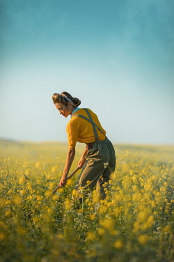 Ildiko Neer Land girl working in rape field Women