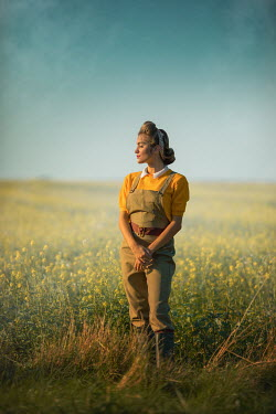 Ildiko Neer Land girl relaxing in rape field