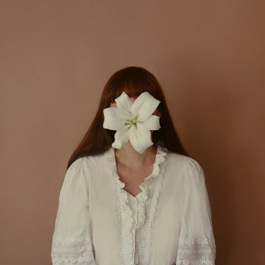 Felicia Simion WOMAN WITH WHITE FLOWER COVERING FACE Women