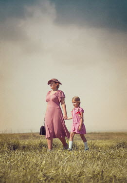 Joanna Czogala RETRO MOTHER AND DAUGHTER WALKING IN COUNTRYSIDE Children