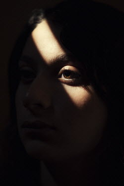 Mohamad Itani CLOSE UP OF SERIOUS FEMALE FACE IN SHADOW Women