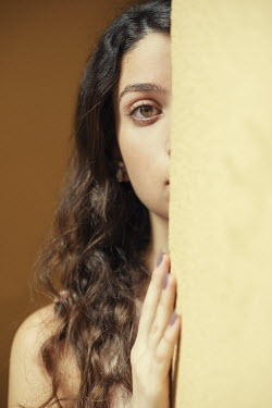 Mohamad Itani GIRL WITH LONG DARK HAIR PEEKING BY WALL Women
