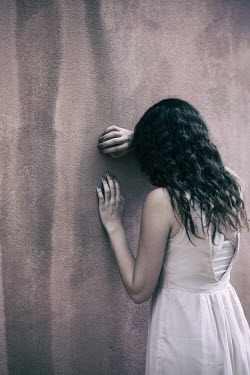 Mohamad Itani GIRL IN DRESS STANDING BY WALL CRYING Women
