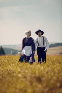 Magdalena Russocka vintage amish couple in field