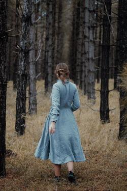 Rekha Garton GIRL WALKING IN FOREST IN WINTRY FOREST Women