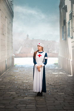 Ildiko Neer Historical wartime nurse standing in town