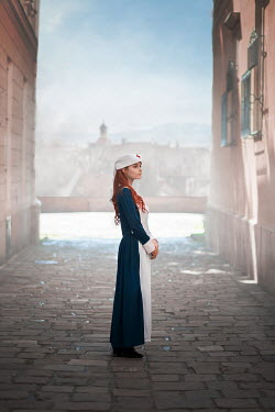 Ildiko Neer wartime nurse standing in city street Women