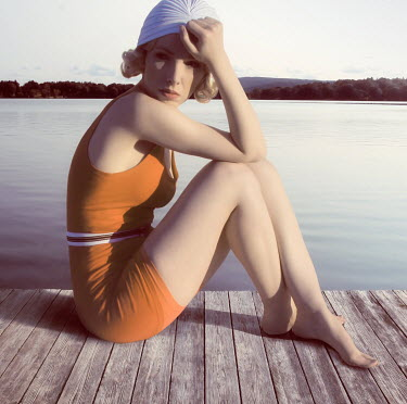 ILINA SIMEONOVA RETRO WOMAN IN SWIMSUIT SITTING ON JETTY Women