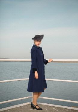 Joanna Czogala BLONDE RETRO WOMAN IN HAT BY SEA Women