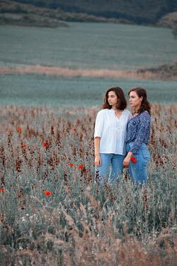 Kerstin Marinov TWO BRUNETTE WOMEN IN FIELD WITH POPPIES Women