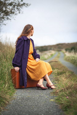 Marie Carr WOMAN SITTING ON SUITCASE IN COUNTRYSIDE Women