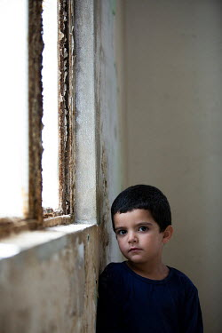 Mohamad Itani SAD LITTLE BOY BY WINDOW IN DERELICT BUILDING Children