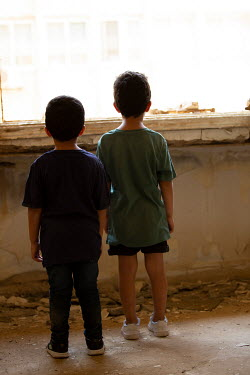 Mohamad Itani TWO LITTLE BOYS BY WINDOW IN DERELICT BUILDING Children