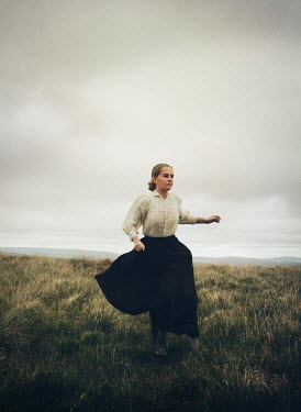 Mark Owen BLONDE HISTORICAL WOMAN RUNNING IN COUNTRYSIDE Women