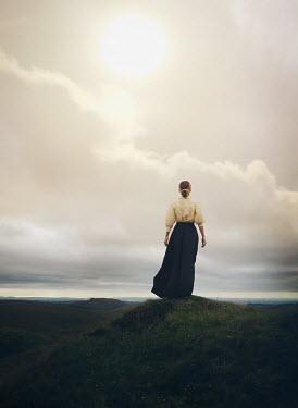 Mark Owen BLONDE HISTORICAL WOMAN IN REMOTE LANDSCAPE Women