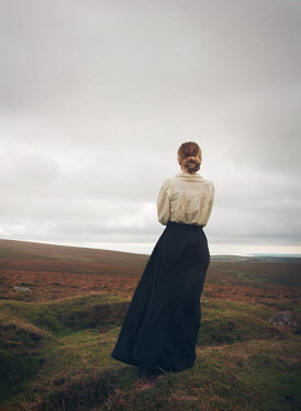Mark Owen BLONDE HISTORICAL WOMAN IN REMOTE LANDSCAPE Women