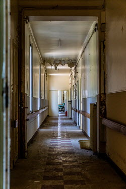 Elly De Vries EMPTY DERELICT CORRIDOR IN HOSPITAL BUILDING Interiors/Rooms