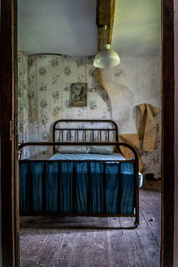 Elly De Vries OLD DERELICT BEDROOM WITH PEELING WALLPAPER Interiors/Rooms