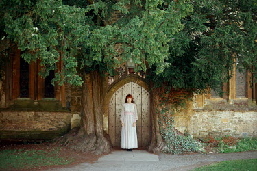 Felicia Simion WOMAN IN DOORWAY OF MEDIEVAL BUILDING WITH TREES Women