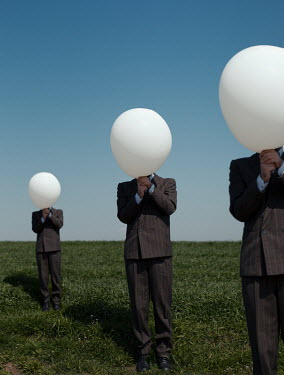 Felicia Simion THREE MEN IN SUITS WITH BALLOONS IN FIELD Groups/Crowds