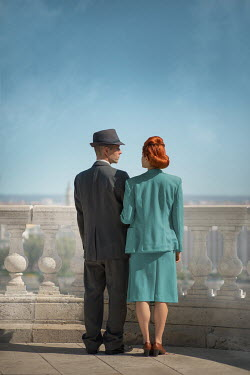 Ildiko Neer Vintage couple standing on balcony