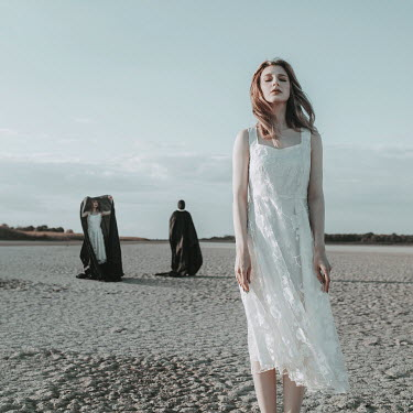 Jovana Rikalo WOMAN ON BEACH WITH TWO PEOPLE IN CAPES Groups/Crowds