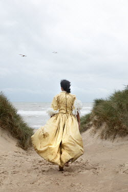 Matilda Delves HISTORICAL WOMAN RUNNING ON SAND DUNES Women