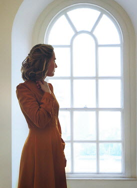 Mark Owen BLONDE WOMAN INDOORS BY ARCHED WINDOW Women