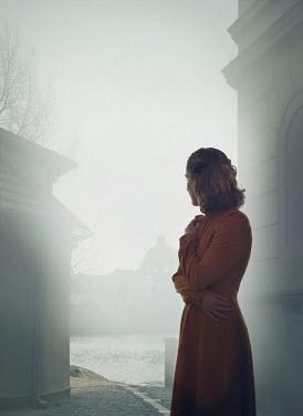 Mark Owen BLONDE WOMAN WATCHING FOGGY URBAN RIVER Women
