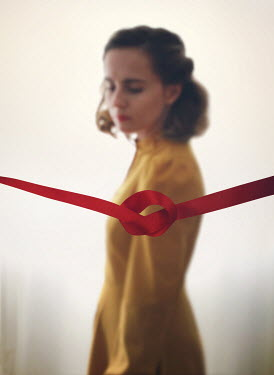 Mark Owen SERIOUS WOMAN WITH KNOTTED RED RIBBON Women
