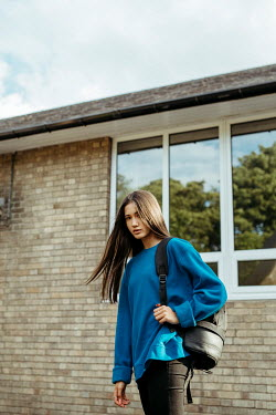 Shelley Richmond ASIAN TEENAGE GIRL WITH BAG OUTSIDE BUILDING Women