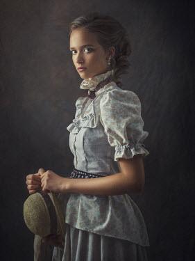 Dmytro Baev YOUNG HISTORICAL BRUNETTE GIRL HOLDING HAT Women