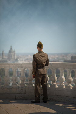 Ildiko Neer Soldier in uniform standing on balcony
