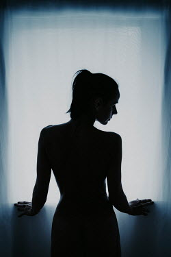 Nic Skerten SILHOUETTED NAKED WOMAN STANDING BY WINDOW Women