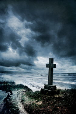 Silas Manhood STONE CRUCIFIX ON BEACH WITH STORMY SKY Statuary/Gravestones