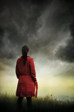 Silas Manhood GIRL IN RED COAT BY SEA WITH STORMY SKY Women