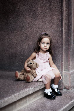Kerstin Marinov CUTE LITTLE GIRL SITTING ON STEP WITH TEDDY BEAR Children