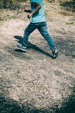 Mohamad Itani LITTLE BOY RUNNING OUTDOORS IN SUMMER Children
