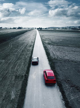 Magdalena Russocka two cars on road in fields from above