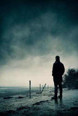 Silas Manhood MAN STANDING ON WINTRY BEACH WAITING Men