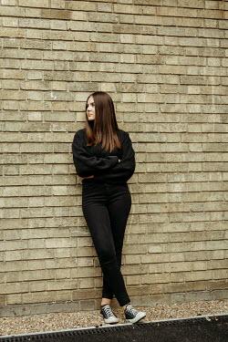 Shelley Richmond BRUNETTE GIRL LEANING ON BRICK WALL Women