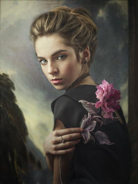 Dmytro Baev Young woman holding pink flower