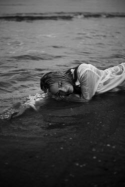 Greta Larosa Young woman lying on beach