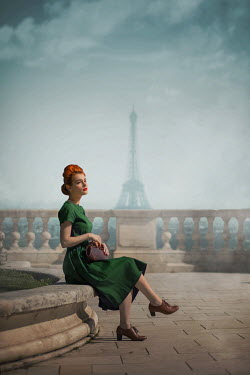 Ildiko Neer Vintage woman sitting on terrace in Paris