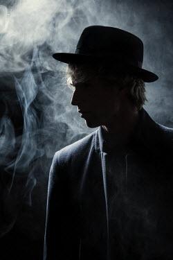 Magdalena Russocka man wearing fedora hat in smoky room